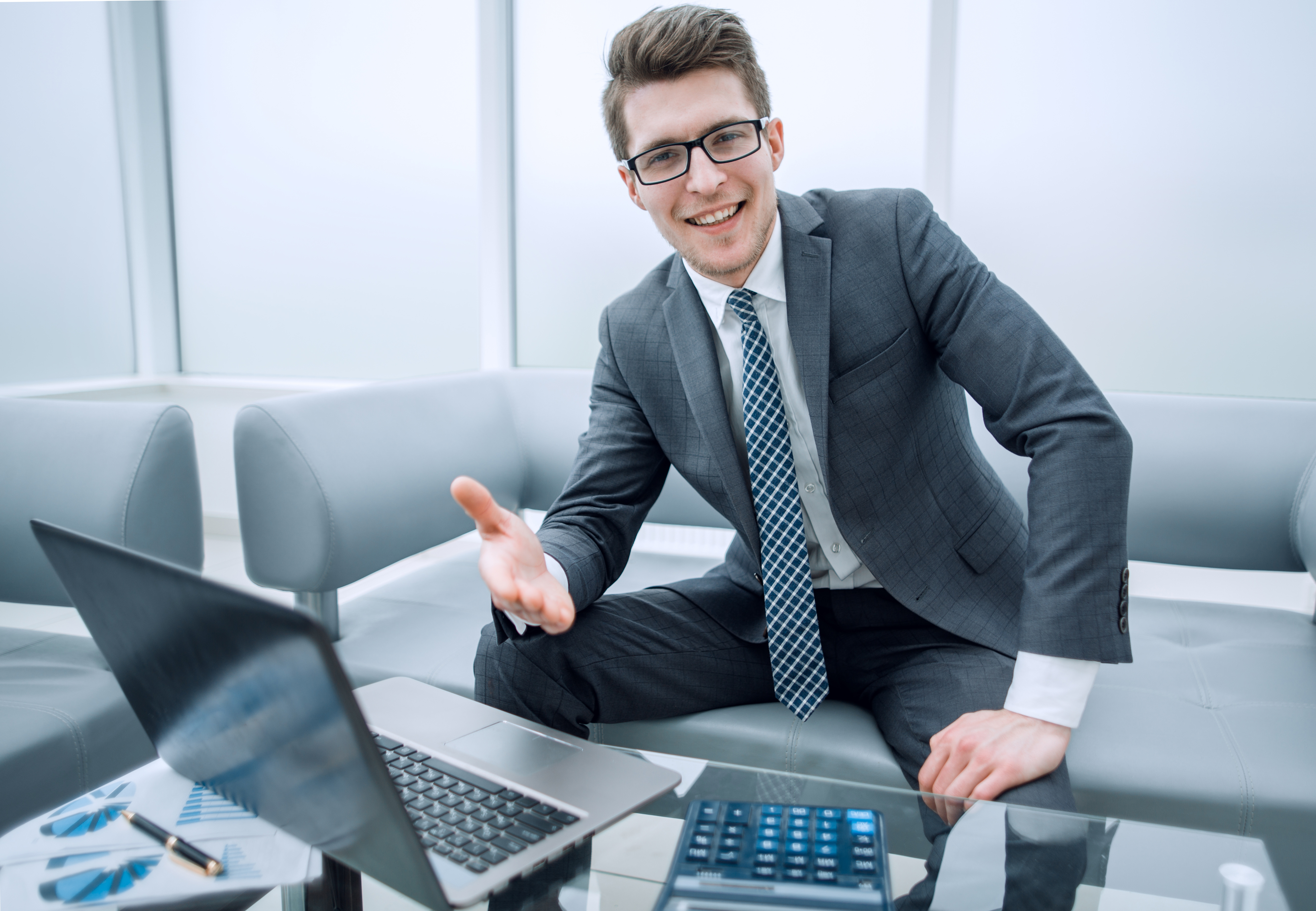 smiling businessman greeting you in his office business concept