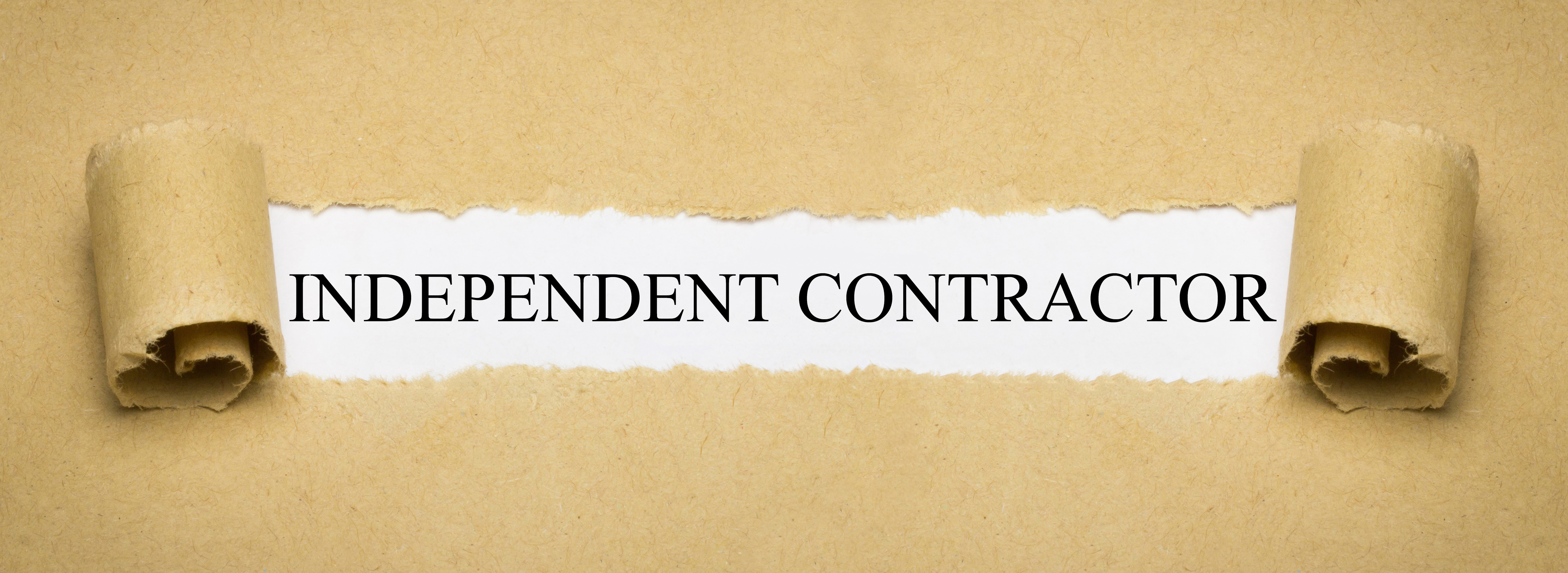 Independent Contractor written on a whitepaper after peeled off brown paper