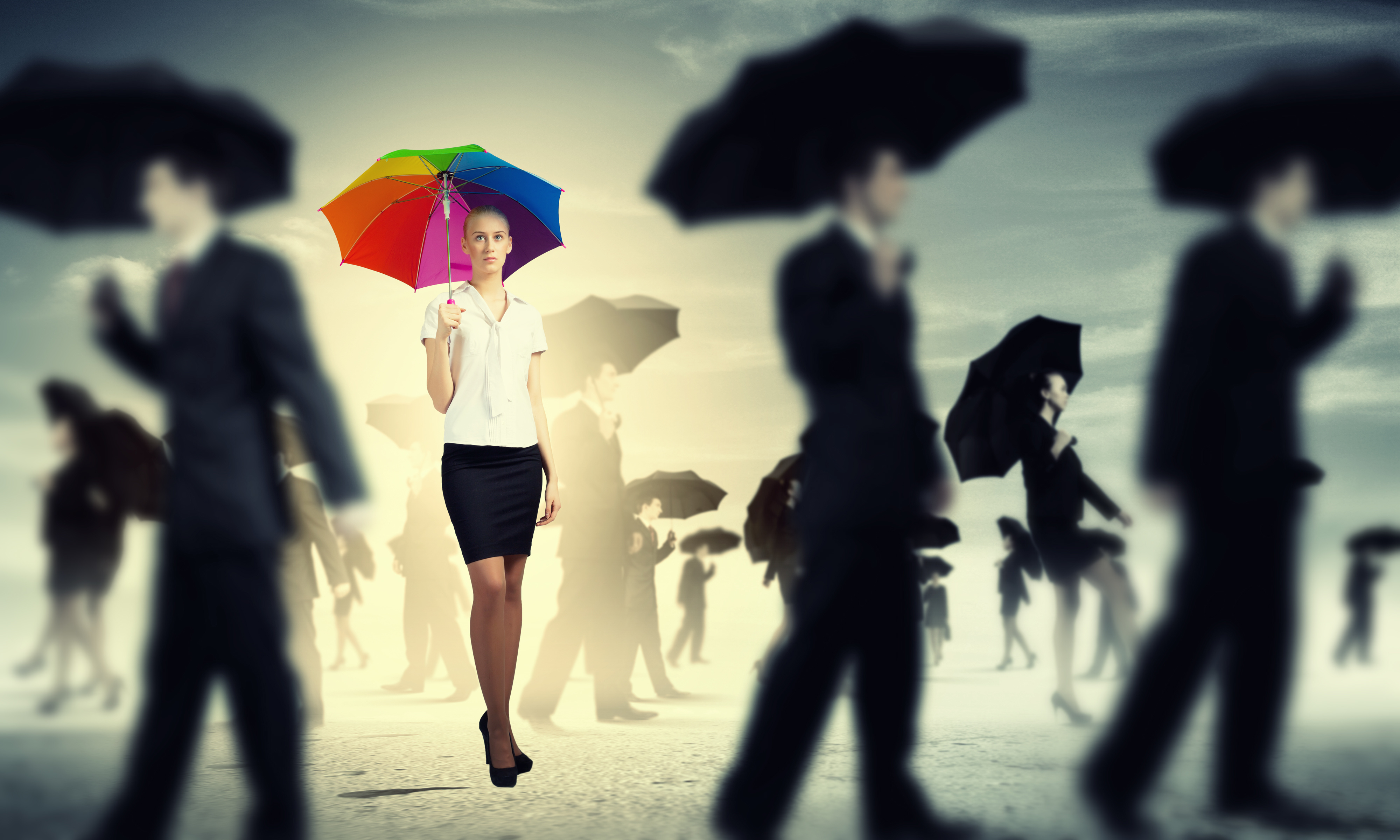 Business woman walking through crowd with umbrella