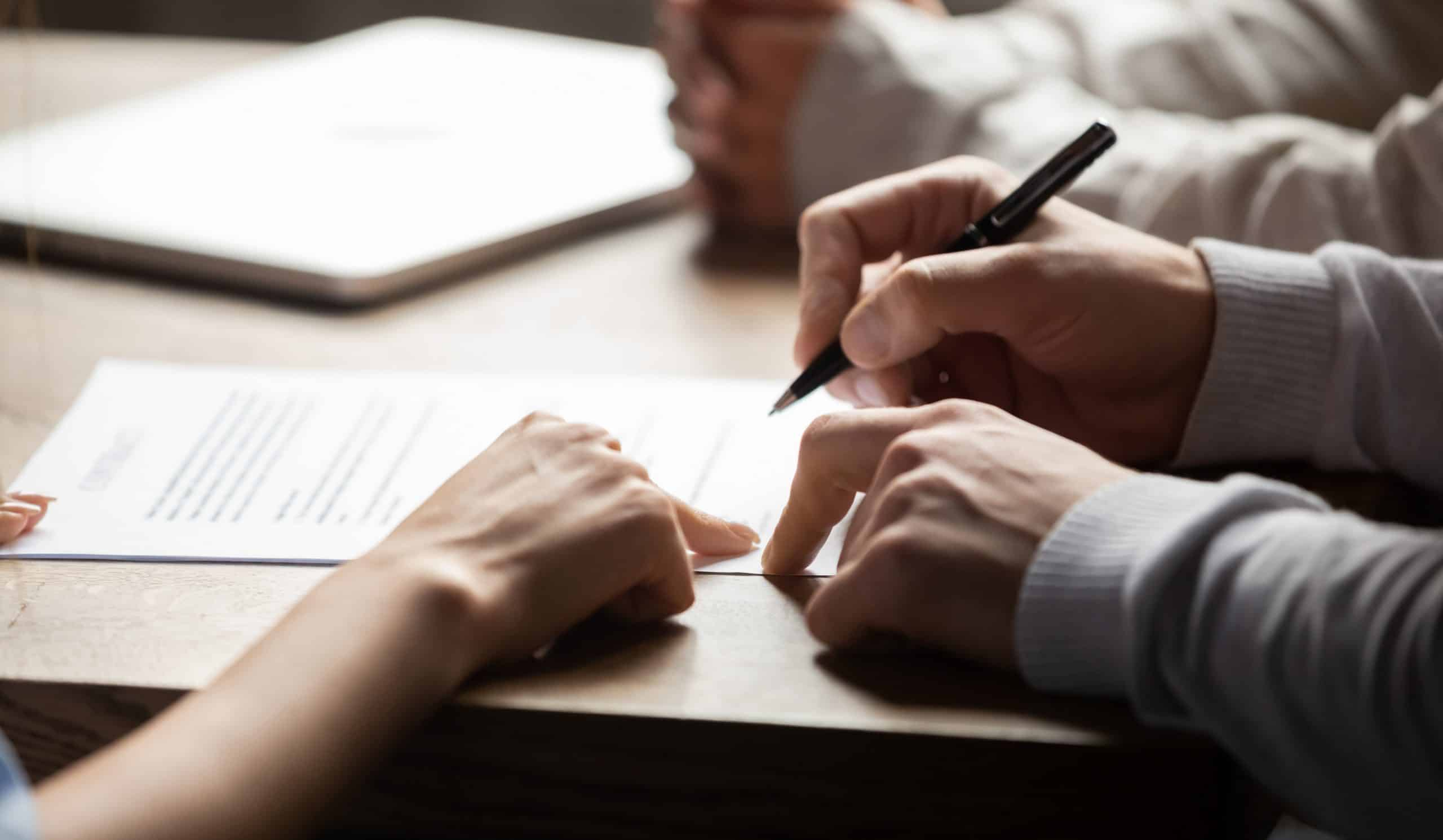 Contractor signing a mortgage agreement